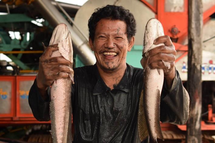 Таец с рыбой